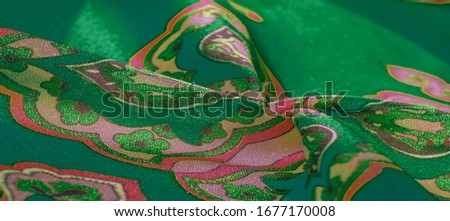 texture, background, multicolored silk fabric with a pattern of patterns on a green background, jacquard pattern #1677170008