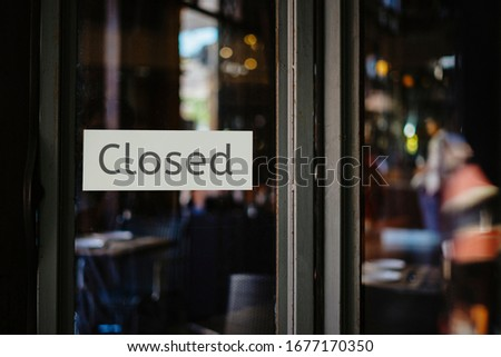 closed sign hanging outside a restaurant, store, office or other #1677170350