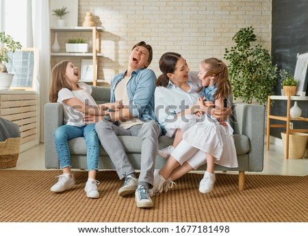 Happy family! Two children daughters with mother and father. Mum, dad and girls laughing and hugging.  #1677181498