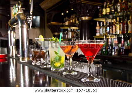 Five cocktails on the bar counter Royalty-Free Stock Photo #167718563