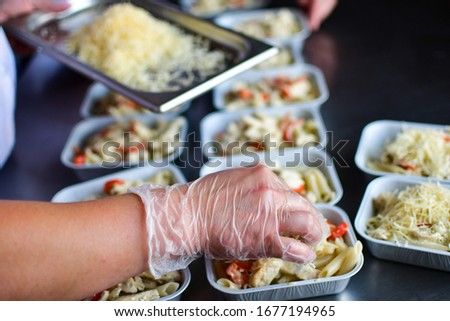 Food delivery. preparing food portions in containers. delivery service during quarantine covid-19. Chicken with vegetables and cheese. airline food. airline meals and snacks. takeaway selective focus #1677194965