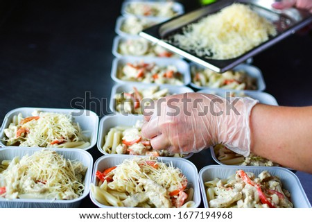 Food delivery. preparing food portions in containers. delivery service during quarantine covid-19. Chicken with vegetables and cheese. airline food. airline meals and snacks. takeaway selective focus #1677194968