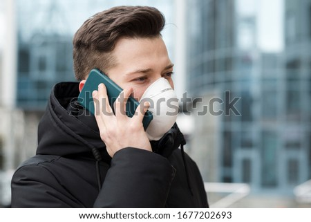 Man talking on the phone while wearing medical mask  #1677202693