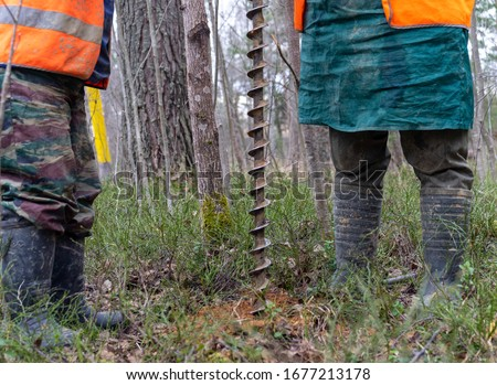 manual geological drilling in engineering geology. geological engineering manual drilling Royalty-Free Stock Photo #1677213178