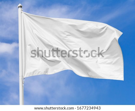 White flag waving in the wind on flagpole against the sky with clouds on sunny day, closeup Royalty-Free Stock Photo #1677234943