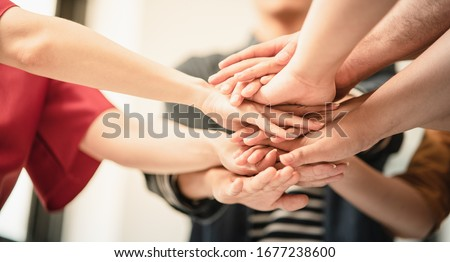 volunteer hand stack people to show teamwork spirit togetherness, Concept community of charity people volunteering with social to achievement in the future, Group of people participation of charity. #1677238600