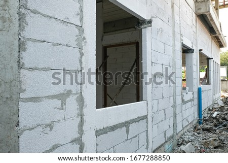 lightweight cement brick and white lintel plaster to joint for reinforce widow house frame in construction site. #1677288850