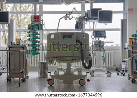 Intensive care unit in hospital, bed with monitors, ventilator, a place where can be  treated patients with pneumonia caused by coronavirus covid 19. Royalty-Free Stock Photo #1677344596