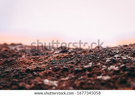 macro picture of red dirt.