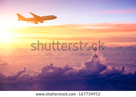 Airplane in the sky at sunrise Royalty-Free Stock Photo #167734952