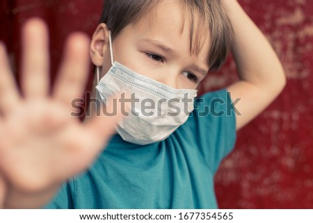 Portrait of Toddler kid wearing medical mask.A boy wearing mouth mask against pandemic. Concept of coronavirus quarantine or covid-19.Protection against virus and infection control concept. #1677354565