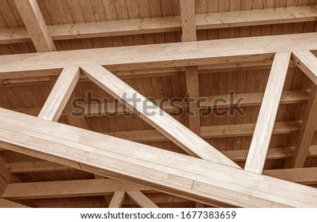 The construction of the wooden roof. Detailed photo of a wooden roof overlap construction. #1677383659