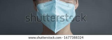 Man wearing n 95 surgical mask. Corona virus protection.  #1677388324