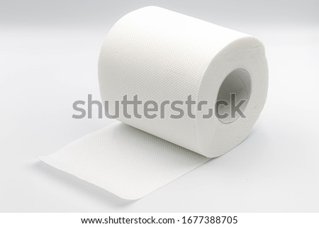 Sanitary and household, Close up detail of one single clean toilet paper roll lay on white background, Tissue is a lightweight paper or light crepe paper. #1677388705