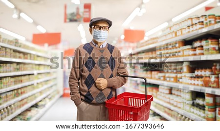 Senior man shopping in a supermarket with a medical face mask  #1677393646