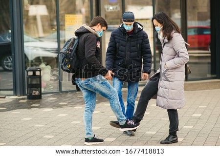 People greeting with foots. Alternative handshake during coronavirus epidemic. Covid 19. Coronavirus prevention. Non-contact greeting. Foot shake style of greetings. Coronavirus epidemic. #1677418813