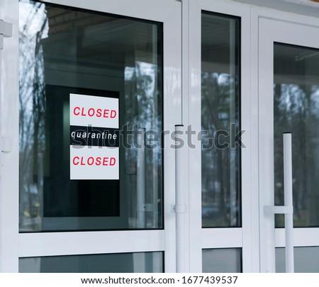 Entrance glass doors with the inscription Closed, quarantine. Stop coronavirus concept #1677439537