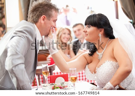 Young newly married couple quarreling at restaurant #167749814