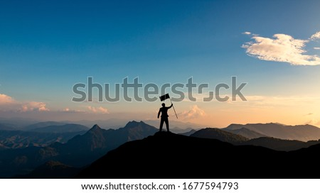 silhouette of businessman with flag on mountain top over sunset sky background, business, success, leadership and achievement concept Royalty-Free Stock Photo #1677594793