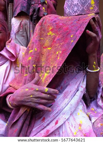 Widows Holi of Vrindavan. A widow tries to protect herself from colours. At Vrindavan the widows are allowed to participate in Holi. Shot on 27th February 2018, Vrindavan, India  #1677643621