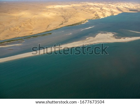 Aerial picture of the landscape of the Namib Desert and the Atlantic Ocean on the Skeleton Coast in western Namibia during summer