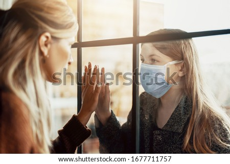 Mother and daughter are separated because of the quarantine Corona Virus Covid-19, social distancing Royalty-Free Stock Photo #1677711757