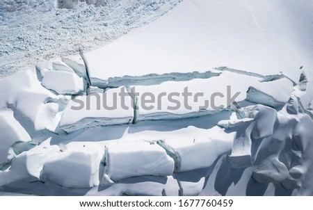 Aerial photo of glacier formation, ice and snow drone view from above. Aerial drone picture of Mount Aspiring Glacier in national park New Zealand. Drone aerial image of majestic glacier and iceberg.