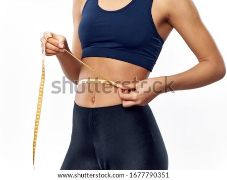 calorie diet centimeter tape beautiful woman #1677790351