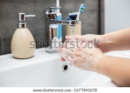 Coronavirus pandemic prevention wash hands with soap warm water and , rubbing nails and fingers washing frequently or using hand sanitizer gel. #1677841078