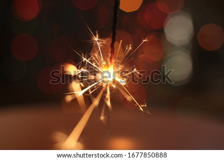 festive burning sparkler macro photo #1677850888