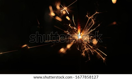 festive burning sparkler macro photo multicolor bokeh garlands #1677858127