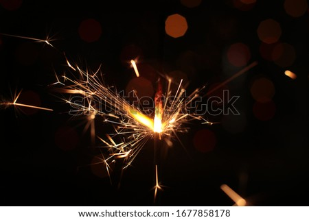 festive burning sparkler macro photo multicolor bokeh garlands #1677858178