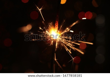festive burning sparkler macro photo multicolor bokeh garlands #1677858181