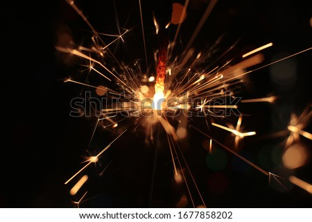 festive burning sparkler macro photo multicolor bokeh garlands #1677858202