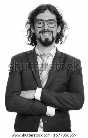 Portrait of happy handsome bearded businessman in suit smiling #1677858559