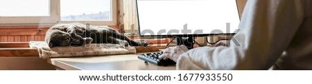 Home based office with IT equipment and online communications. Working at home and remote access concept. Panoramic. #1677933550
