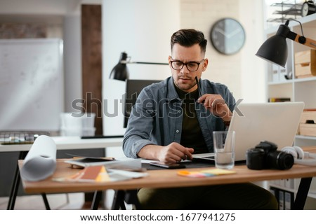 Young stressed handsome businessman working in office. Angry businessman with too much work in office.  #1677941275