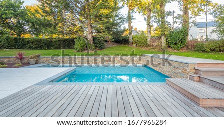 home swimming pool in garden and terrace Royalty-Free Stock Photo #1677965284