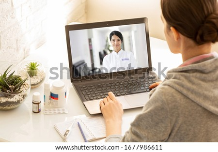 Woman sitting at home during an online consultation with her general practitioner. Medical technology, video chat with a doctor #1677986611