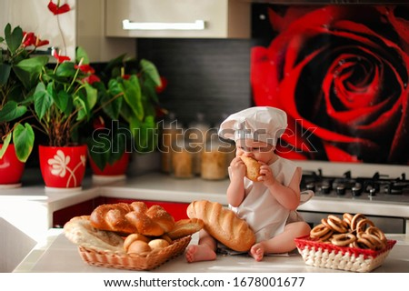 cook little boy in the kitchen #1678001677