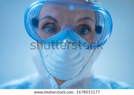 Medical doctor, scientist in full body suit for prevention from viruses and diseases. Royalty-Free Stock Photo #1678015177