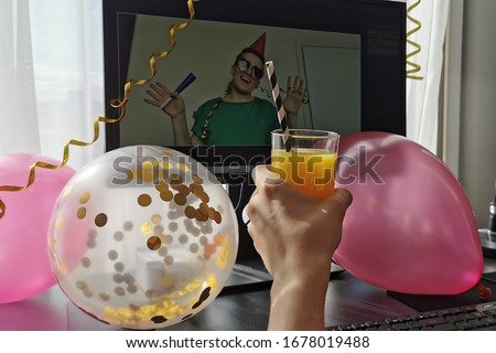 Distance birthday, love, social distancing, friendship, surprise,  quarantine, isolation, stay at home,  self-isolation concept. Birthday congratulation through the computer screen. Selective focus.  Royalty-Free Stock Photo #1678019488