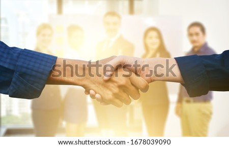 Close up people hands shake business partnership success,Shake hand concept #1678039090