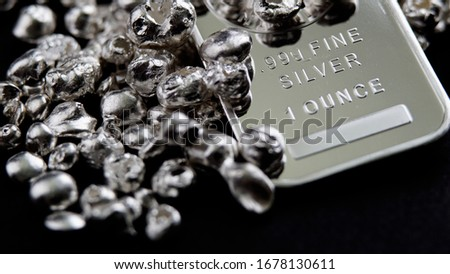 Pure silver precious metals investment                               Royalty-Free Stock Photo #1678130611