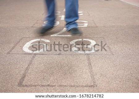 teenager playing hopscotch on playground outdoors, children outdoor activities #1678214782