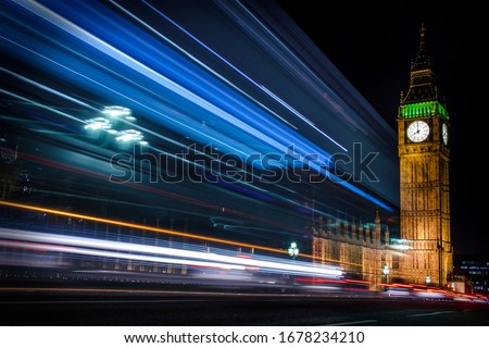 Big Ben at night. Bus passing by. Long exposure photography over the Westminster bridge. London, England, United Kingdom.