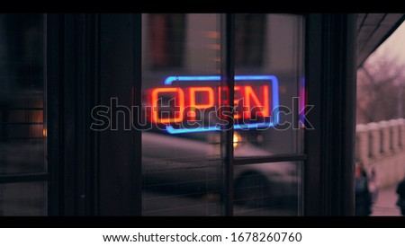 """Open"" sign in city centre, Moscow, Russia"