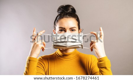 Woman wearing an anti virus protection mask to prevent others from corona COVID-19 and SARS cov 2 infection Royalty-Free Stock Photo #1678274461