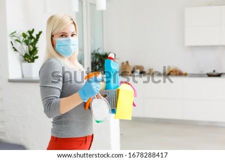 Cleaning and Disinfection at town complex amid the coronavirus epidemic. Professional teams for disinfection efforts. Infection prevention and control of epidemic. Protective gloves and mask #1678288417