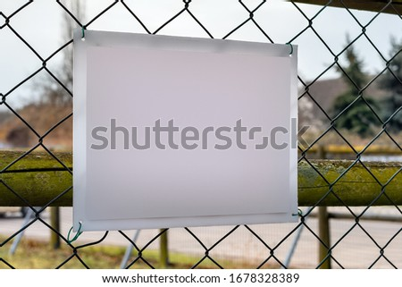 Plastic Bulletin Sign Board on the Chain-Link Fence Mockup